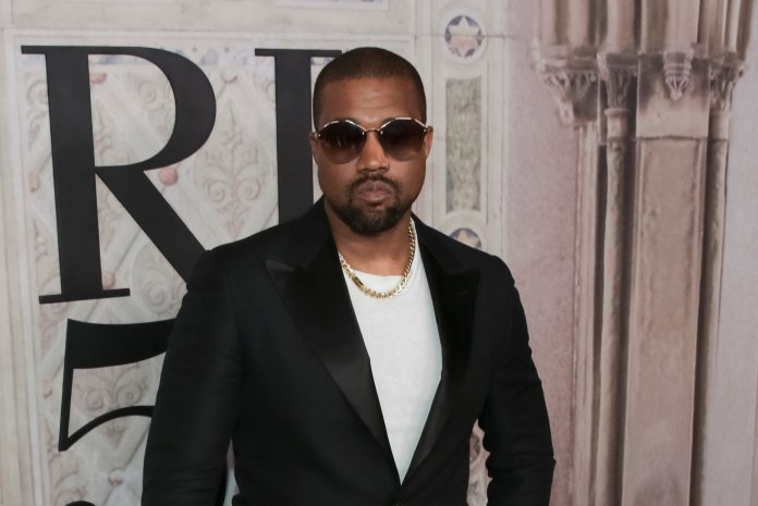 """In this Sept. 7 file photo, Kanye West attends the Ralph Lauren 50th Anniversary Event in Central Park during New York Fashion Week. President Donald Trump has panned Saturday Night Live's season premiere but tweeted praise for Kanye West. As the show ended, West took the stage wearing a """"Make America Great Again"""" hat and made an unscripted pro-Trump speech after the credits rolled. (Brent N. Clarke/AP, File)"""