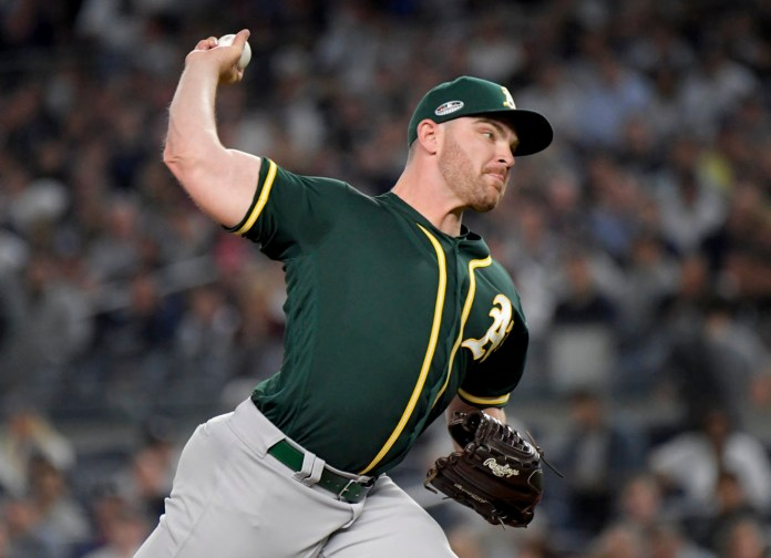 Oakland Athletics pitcher Liam Hendriks delivers against the New York Yankees during the first inning of the American League wildcard playoff baseball game, Wednesday, Oct. 3, 2018, in new York (AP Photo/Bill Kostroun)