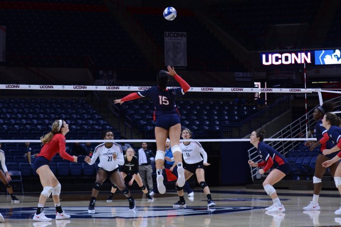 Iman McGary rises above the competition to hit the ball during a match against Cincinnati on Oct. 7, 2018. (Judah Shingleton/ The Daily Campus)