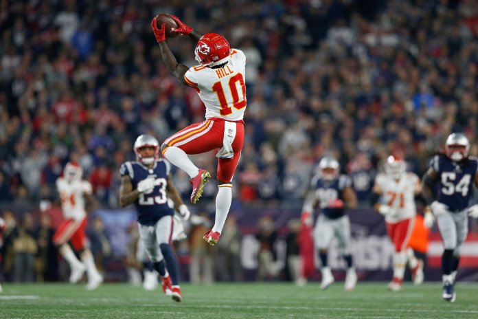 Tyreek Hill catches a pass that he ran in for a touchdown during the second half  against the New England Patriots, Sunday, Oct. 14, 2018, in Foxborough, Mass. (AP Photo/Michael Dwyer)