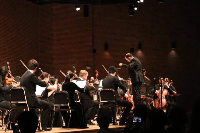 """The UConn Symphony Orchestra performs a show titled """"Dances in Masks"""" in von der Mehden Recital Hall on Thursday night. The show featured works by Bernstein, Fuchs, Saint-Seans, and Tchaikovsky. (Photo by Maggie Chafouleas/The Daily Campus)"""