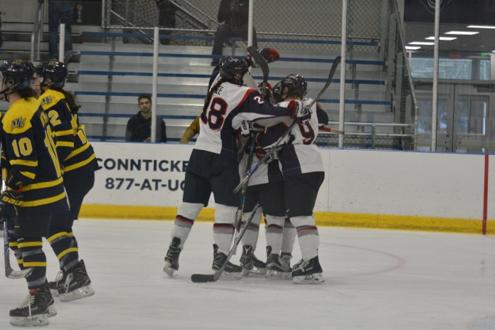 UConn Women's Hockey celebrates after a win at Freitas Ice Forum (File Photo/The Daily Campus)