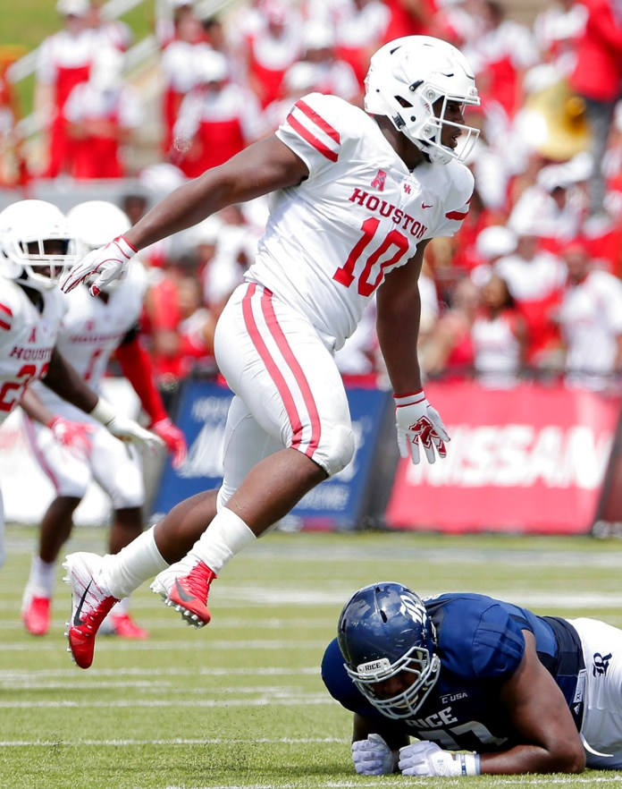 FILE - In this Sept. 1, 2018, file photo, Houston defensive tackle Ed Oliver (10) jumps over Rice offensive lineman Uzoma Osuji during a NCAA college football game, in Houston. (AP Photo/Michael Wyke, File)