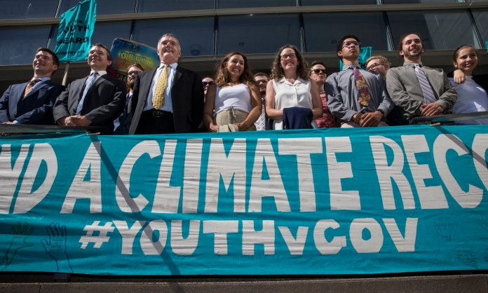 In this July 18, 2018 file photo, lawyers and youth plaintiffs lineup behind a banner after a hearing before Federal District Court Judge Ann Aiken between lawyers for the Trump Administration and the so called Climate Kids in Federal Court in Eugene, Ore. The extreme crisis of climate change can be attributed to lack of foresight. (Chris Pietsch/The Register-Guard via AP, File)