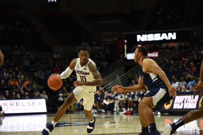Brendan Adams gears up to drive the ball past an SCSU defender in UConn's 96-64 exhibition win on Friday, Nov. 2 at Gampel Pavilion. (Charlotte Lao/The Daily Campus)
