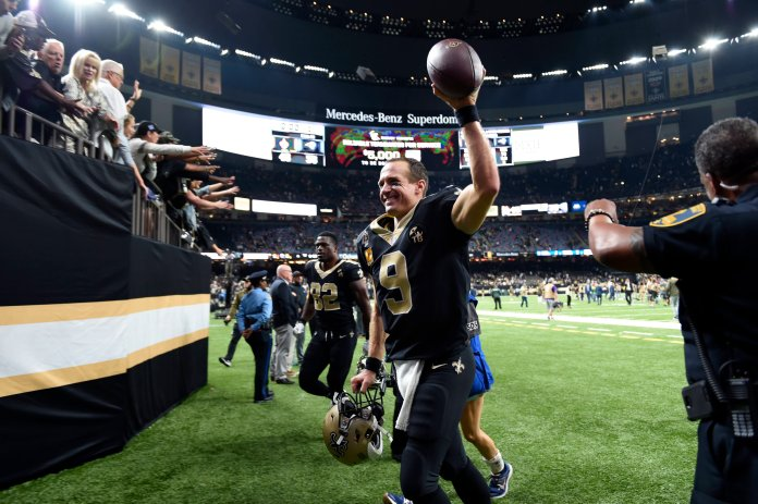 New Orleans Saints quarterback Drew Brees (9) reacts to fans after an NFL football game against the Los Angeles Rams in New Orleans. The Saints won 45-35. (AP Photo/Bill Feig)