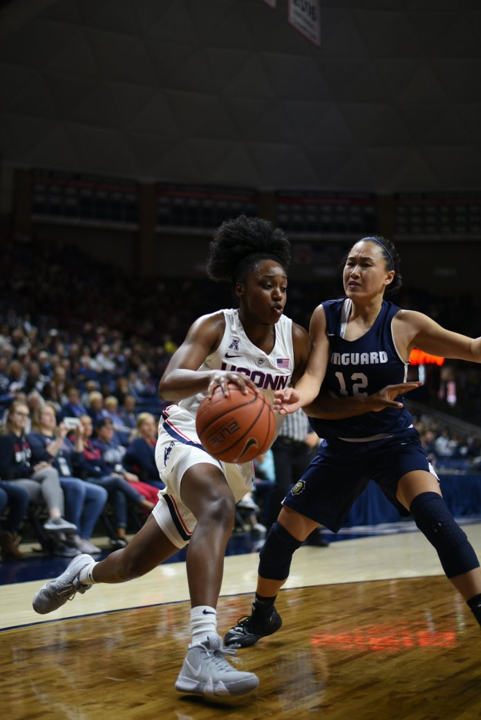 Freshman guard Christyn Williams drives past a Vanguard defender during the Huskies 96-30 win on Nov. 4, 2018. (Charlotte Lao/ The Daily Campus)