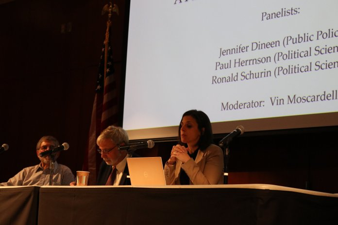 Panelists discussed and answered questions on the outcome of the 2018 elections in Konover auditorium on Wednesday afternoon. (Maggie Chafouleas/The Daily Campus)