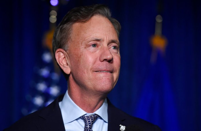 """Governor-elect Ned Lamont reacts when speaking to supporters in Hartford, Conn., Wednesday, Nov. 7, 2018. Lamont won election Wednesday as Connecticut's governor, keeping the office in Democratic hands in part by promising to be a """"firewall"""" against the policies of President Donald Trump. (AP Photo/Jessica Hill)"""