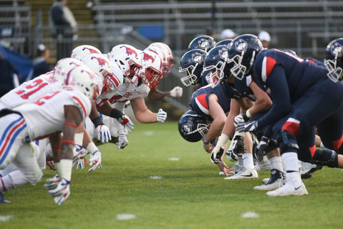 SMU rushes UConn's offensive line during a game on Nov. 10, 2018. (Charlotte Lao/ The Daily Campus)