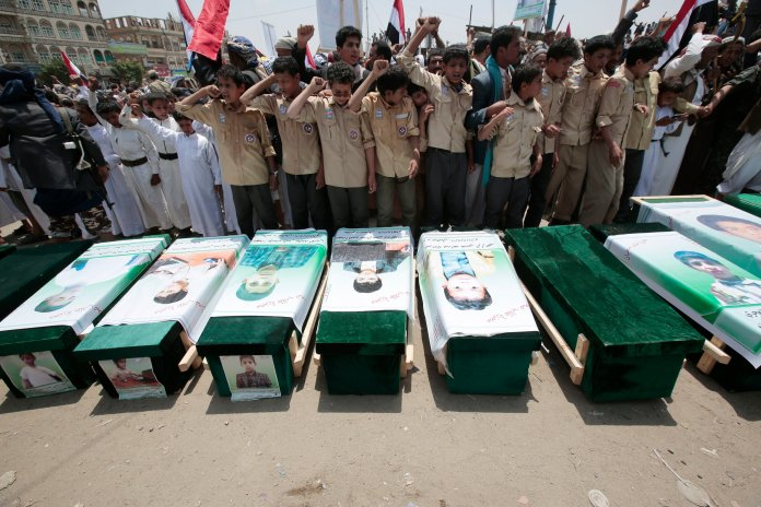 FILE - In this Aug. 13, 2018, file photo, Yemeni people attend the funeral of victims of a Saudi-led airstrike, in Saada, Yemen. (AP Photo/Hani Mohammed, File)