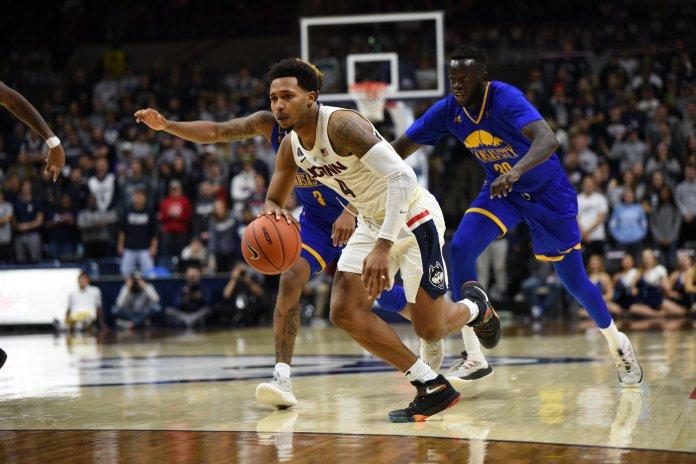 Jalen Adams pushes the ball down the court against UMKC on Nov. 11, 2018. (Nicholas Hampton/ The Daily Campus)