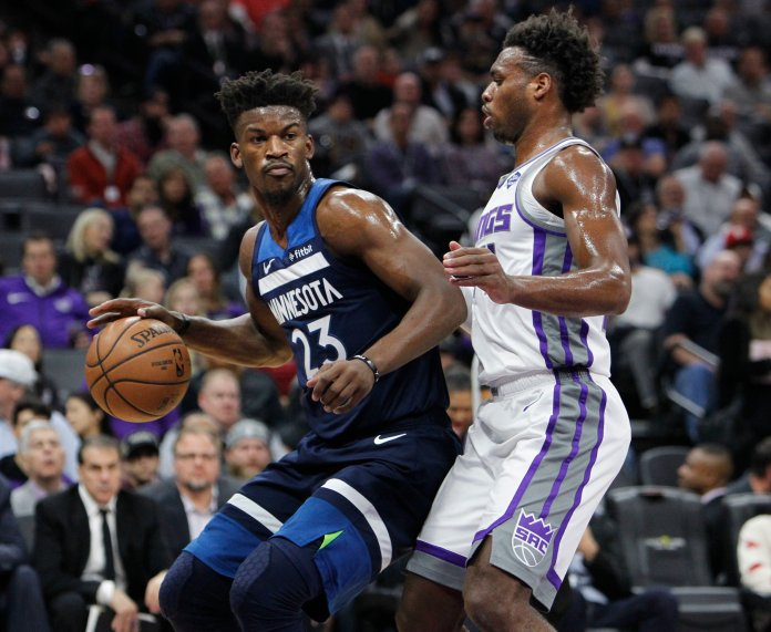 Former Minnesota Timberwolves guard Jimmy Butler (23) battles for position against Sacramento Kings guard Buddy Hield (24) during a game in Sacramento on Friday, Nov. 9. (Steve Yeater/AP)