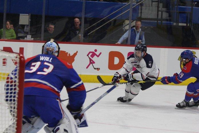 Alexander Payusov crashes the net. (Bryan Lambert/ The Daily Campus)