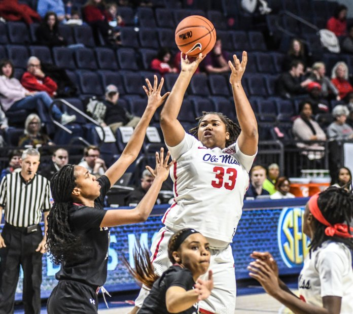 Mississippi's La'Karis Salter (33) shoots over Temple's Shannen Atkinson (11) during a game on Wednesday, Nov. 14 in Oxford, Miss. (Bruce Newman/The Oxford Eagle via AP)