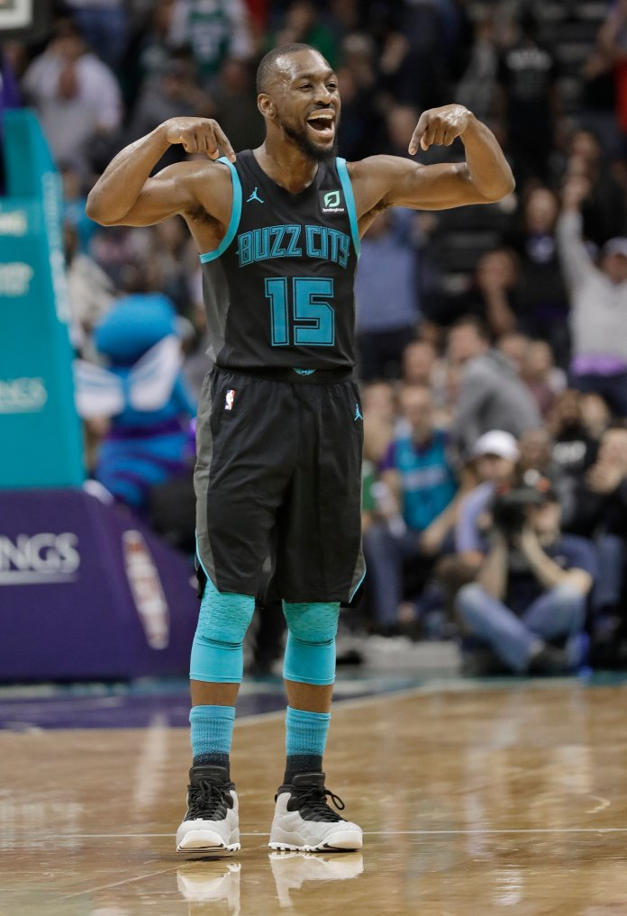Charlotte Hornets' Kemba Walker reacts after a basket against the Boston Celtics during a game in Charlotte on Monday, Nov. 19. (Chuck Burton/AP)