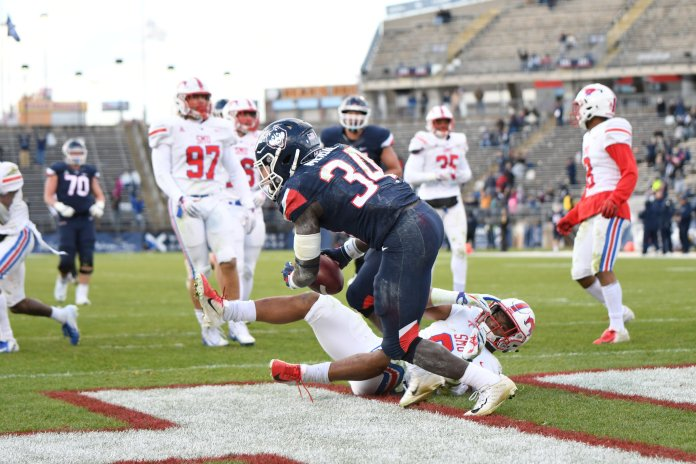 Running back Kevin Mensah scores a touchdown during a game against SMU on Saturday, Nov. 10 at Rentschler Field (Charlotte Lao, Photo Editor/The Daily Campus)