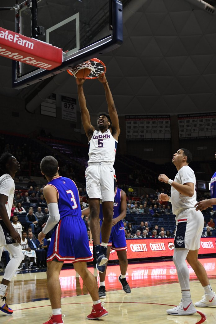 Isaiah Whaley slams home a dunk during UConn's win over UMass-Lowell on Nov. 27, 2018. (Nicholas Hampton/ The Daily Campus)