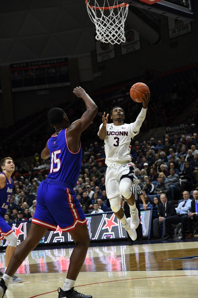Alterique Gilbert takes a left-handed layup during the Huskies 97-75. (Nicholas Hampton/ The Daily Campus)