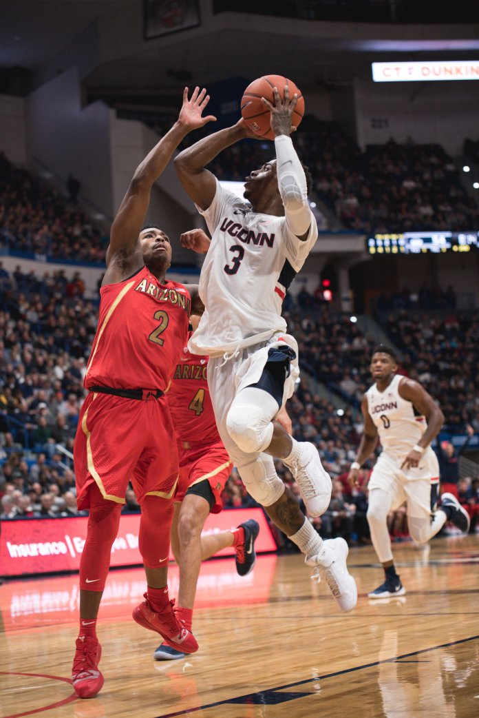 Alterique Gilbert drives to the hole against Arizona. (Charlotte Lao/ The Daily Campus)