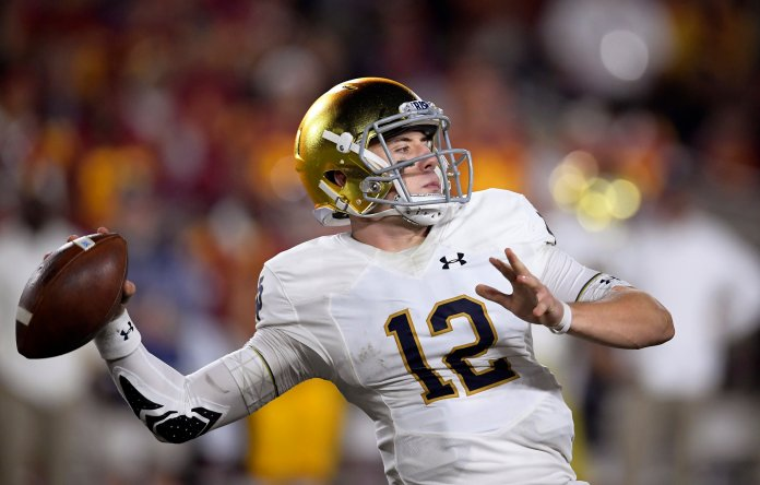 FILE -Notre Dame quarterback Ian Book throws a pass during a college football game against Southern California. No. 2 Clemson plays No. 3 Notre Dame in the Cotton Bowl on Dec. 29, 2018. (AP Photo/Mark J. Terrill, File)