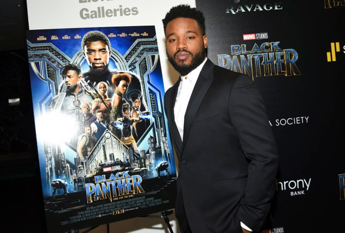 """FILE - In this Feb. 13, 2018 file photo, director Ryan Coogler attends a special screening of """"Black Panther"""" in New York. As Hollywood's awards season properly gets under way, """"Black Panther"""" is poised to be the first comic book film to be nominated for best picture. (Photo by Evan Agostini/Invision/AP, File)"""