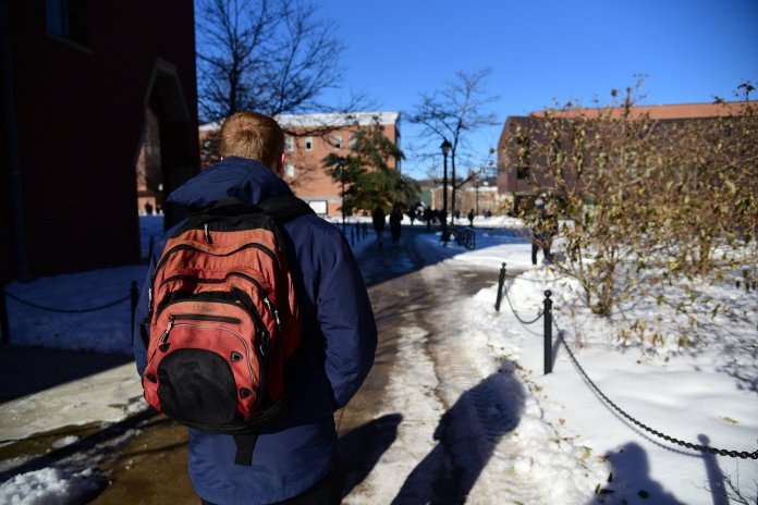 Students around campus walking around, doing their best to not to slip and fall. (Kush Kumar/The Daily Campus)