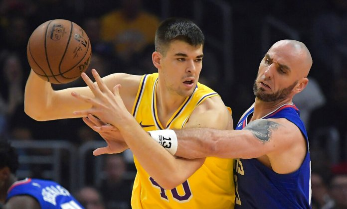 Los Angeles Clippers center Marcin Gortat, right, reaches for the ball held by Los Angeles Lakers center Ivica Zubac during the first half of an NBA basketball game Thursday, Jan. 31, 2019, in Los Angeles. (AP Photo/Mark J. Terrill)