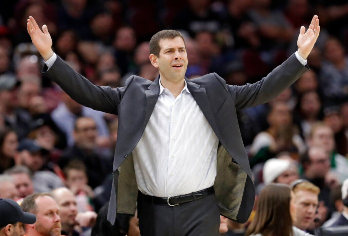 Boston Celtics coach Brad Stevens argues a call by an official during the second half of the team's NBA basketball game against the Cleveland Cavaliers, Tuesday, Feb. 5, 2019, in Cleveland. Boston won 103-96. (AP Photo/Tony Dejak)