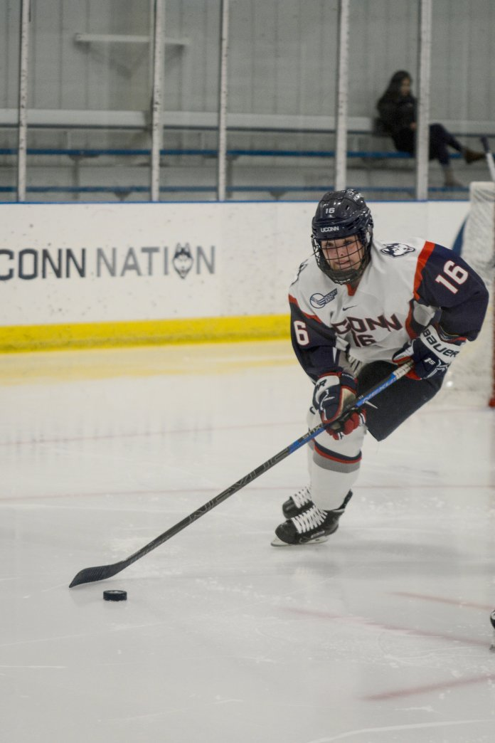 Sophomore defenseman Taylor Wabick possesses the puck for UConn (Eric Wang/The Daily Campus)
