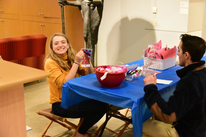 Benton Museum's First Thursdays offers arts and crafts (this time making your own Valentine's Cards), open mic night and a scavenger hunt upstairs with a live band, the UConn Jazz Trio. (Kush Kumar/The Daily Campus)