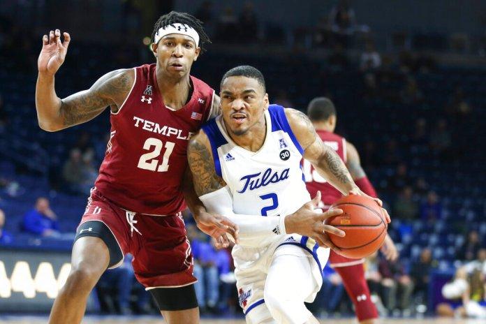 Tulsa guard DaQuan Jeffries (2) drives past Temple forward Justyn Hamilton (21) during an NCAA college basketball game at the Reynolds Center in Tulsa, Okla., Saturday, Feb. 9, 2019. (Ian Maule/Tulsa World via AP)