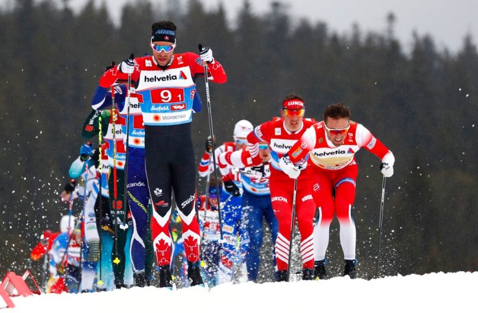 Canada's Alex Harvey, left, competes in a men's cross country 4x10km relay, at the Nordic ski World Championships in Seefeld, Austria, Friday, March 1, 2019. (AP Photo/Matthias Schrader)
