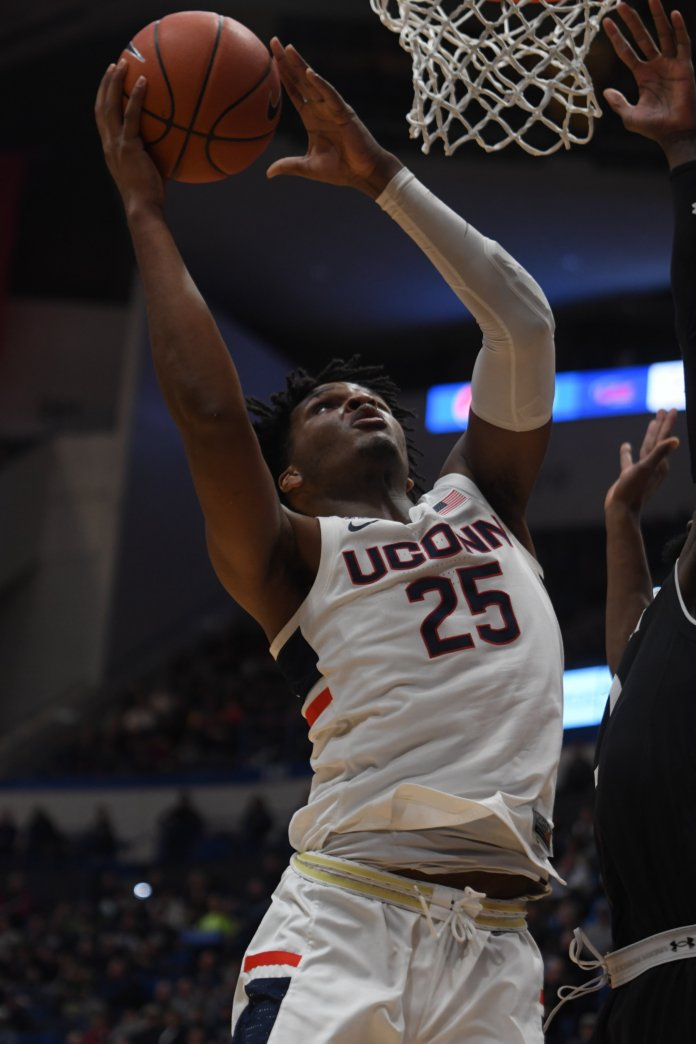 Josh Carlton helped lead UConn to a big win over USF with 16 points, nine rebounds, three assists, three steals and blocked one shot (Photo by Judah Shingleton/The Daily Campus)