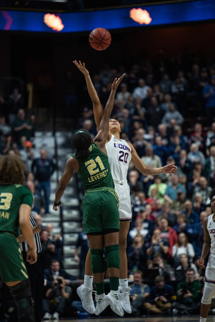 Olivia Nelson-Ododa soars over a USF player in the Huskies' victory Sunday. (Charlotte Lao/The Daily Campus)