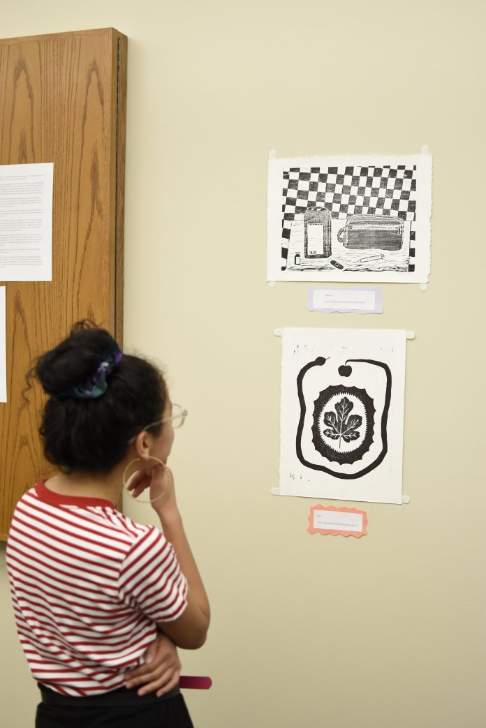 Student art is put on display at the Rainbow Center. The art pieces cover a wide array of subjects and tackle these subjects through multiple mediums such as photography, print or written word. (Brandon Barzola/The Daily Campus)