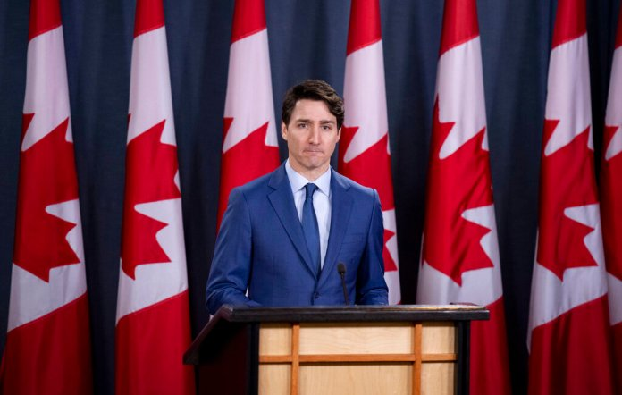 Prime Minister Justin Trudeau delivers remarks at the National Press Theatre in Ottawa on Thursday, March 7, 2019. (Justin Tang/The Canadian Press via AP)