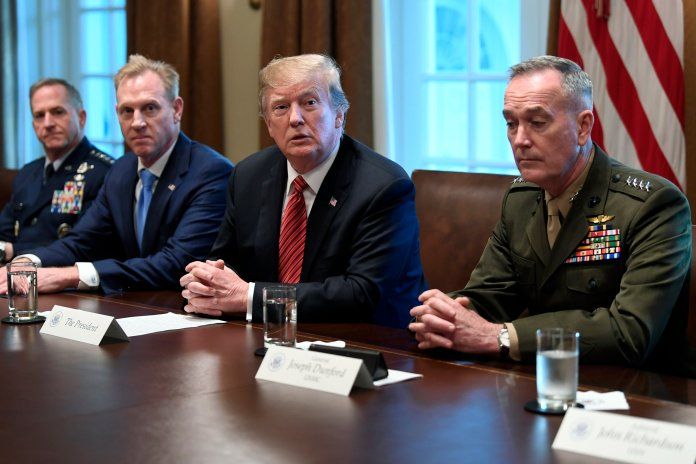 President Donald Trump, second from right, flanked by acting Defense Secretary Patrick Shanahan, second from left, and Chairman of the Joint Chiefs of Staff Gen. Joseph Dunford, right, speaks during a meeting with military leaders in the Cabinet Room of the White House in Washington, Wednesday, April 3, 2019. At left is Air Force Chief of Staff Gen. David Goldfein. (AP Photo/Susan Walsh)