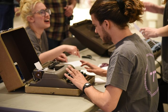 The Benton museum hosts its third First Thursday, this time featuring literary based trivia, bookmark making, Game of Thrones themed picture booth and by demand poetry written by students from The long River Review like Danny. (Kush Kumar/The Daily Campus)