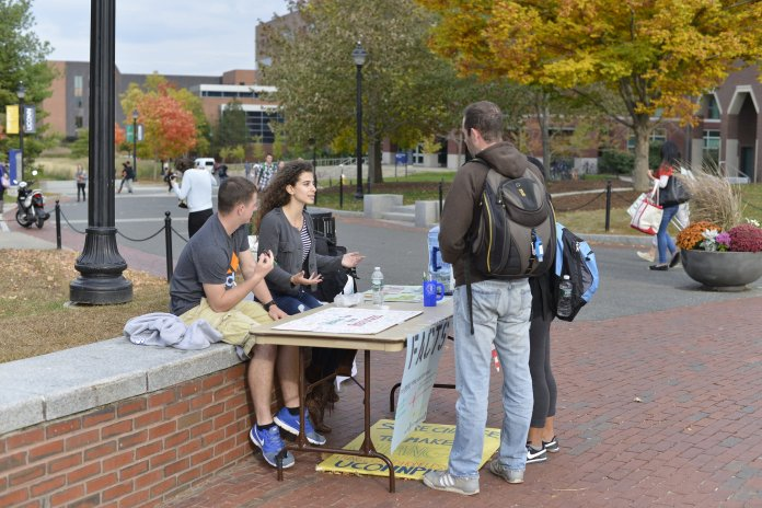 Members of UConnPIRG tabling on Fairfield Way. The non-partisan student advocacy group is planning six different campaigns for the semester, such as a movement for transparency of college textbook costs.  File Photo/The Daily Campus