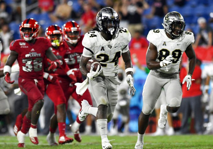 UCF running back Bentavious Thompson breaks free for a touchdown against Florida Atlantic during the second half of an NCAA college football game.   Photo by Jim Rassol/Associated Press
