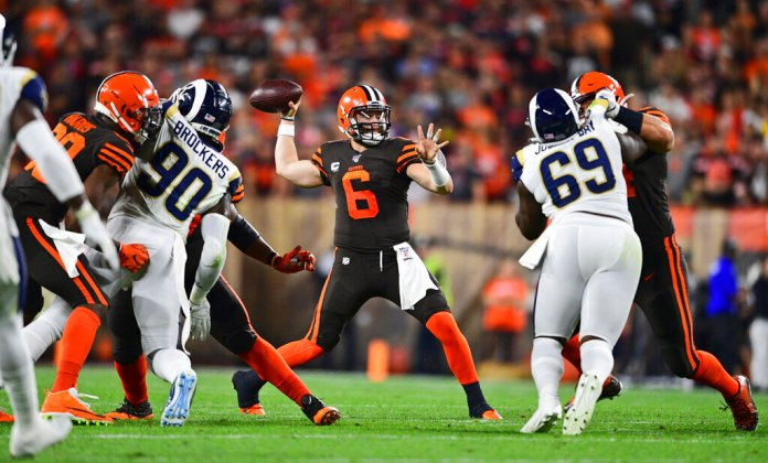 Cleveland Browns quarterback Baker Mayfield (6) looks to throw during the first half of an NFL football game against the Los Angeles Rams.   Photo by David Dermer/AP