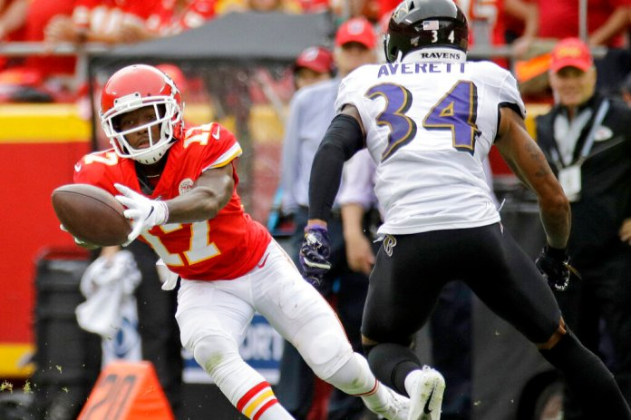 Kansas City Chiefs wide receiver Mecole Hardman (17) makes a catch in front of Baltimore Ravens cornerback Anthony Averett (34).   Photo by Charlie Riedel/AP