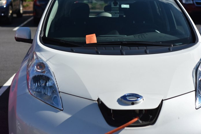 Different examples of parking tickets given out around campus, including electric cars given tickets while charging, and a women who found a ticket on her car after parking behind the gym.  Photo by Mike McClellan/The Daily Campus