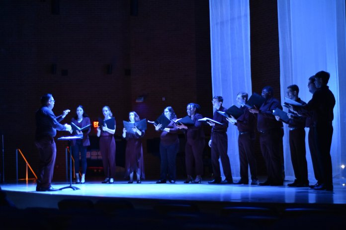 TIME is a collaborative project between the UConn Fine arts department, Digital Media Design, and Physics department. The show was a multimedia experience, involving visuals projected onto multiple screens, a choir, and a quartet.  Photo by Michael McClellan / The Daily Campus
