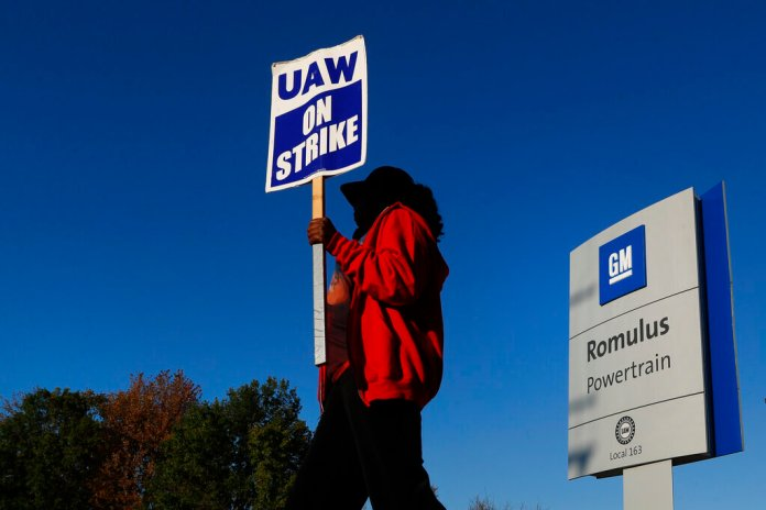 Yolanda Jacobs, a United Auto Workers member, walks the picket line at the General Motors Romulus Powertrain plant in Romulus, Mich., Wednesday, Oct. 9, 2019. Nearly four weeks into the United Auto Workers' strike against GM, employees are starting to feel the pinch of going without their regular paychecks.  Photo by Paul Sancya/AP