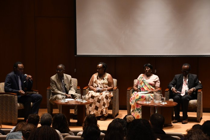 Survivors of the Rwandan Genocide tell their stories in Konover Auditorium Tuesday. The discussion was facilitated by a translator so the survivors were able to share their experiences in their native language.  Photo by Julie Spillane/The Daily Campus
