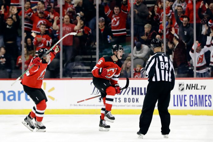 It was younger brother Jack who struck first, netting his first goal of the season in the first period to give the Devils the early lead.  Photo from the Associated Press.