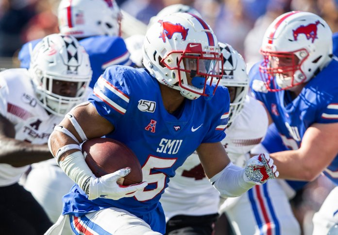 No. 19 SMU continued its hot streak, beating the Temple Owls 45-21 this weekend with a career game from their quarterback.  Photo from the Associated Press.