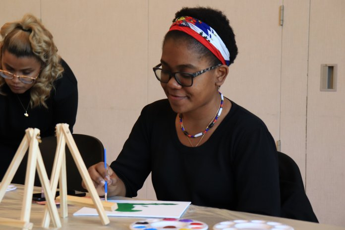 """USG provided students with a positive avenue to express their culture on campus with """"Out Roots on Campus"""". Students gathered in the Student Union to celebrate cultural roots and traditions through painting.  Photo by Erin Knapp/The Daily Campus"""
